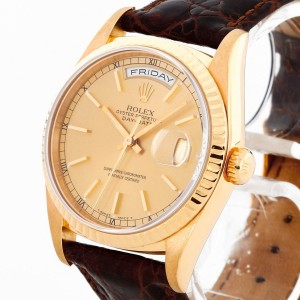 Rolex Oyster Perpetual Day-Date 18 K Gelbgold an Lederband Ref. 18238