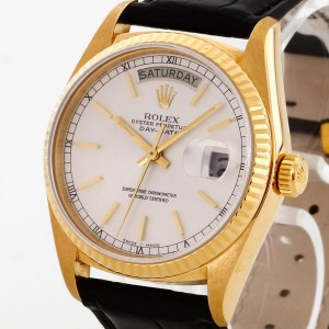 Rolex Oyster Perpetual Day-Date 18 k gold with leather strap Ref.18038
