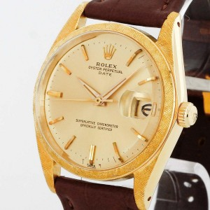 Rolex Oyster Perpetual Date 18 K Gold Florentine Finish an Lederband Ref. 1502
