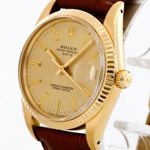 Rolex Oyster Perpetual Date 18 k yellow gold with leather strap Ref. 15038