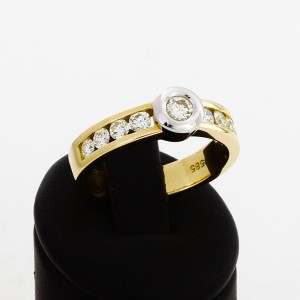 Ring 14 k yellow gold/white gold with brilliants with totally 0,75 ct.