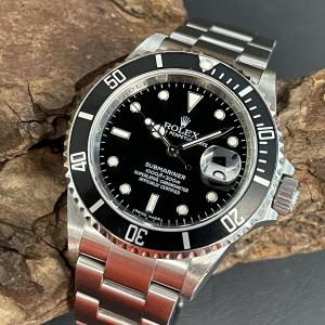 Rolex Submariner Date Box+Papiere Ref. 16610
