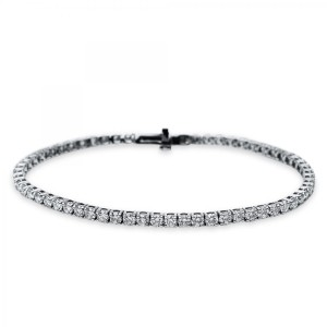 Bracelet 4 prong 18 ct white gold with 63 brilliants ca. 5,00 ct